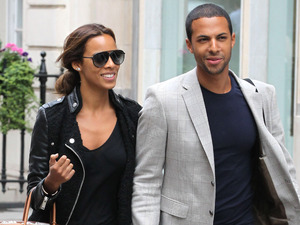 Rochelle Humes and Marvin Humes walking in London