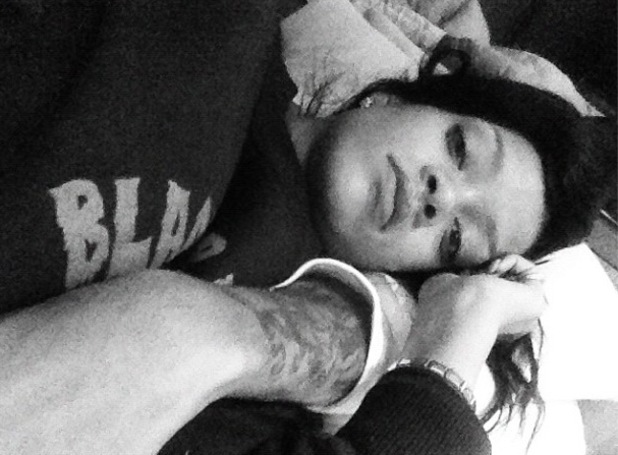 Rihanna tweets picture of her lying in what seems to be Chris Brown's arms