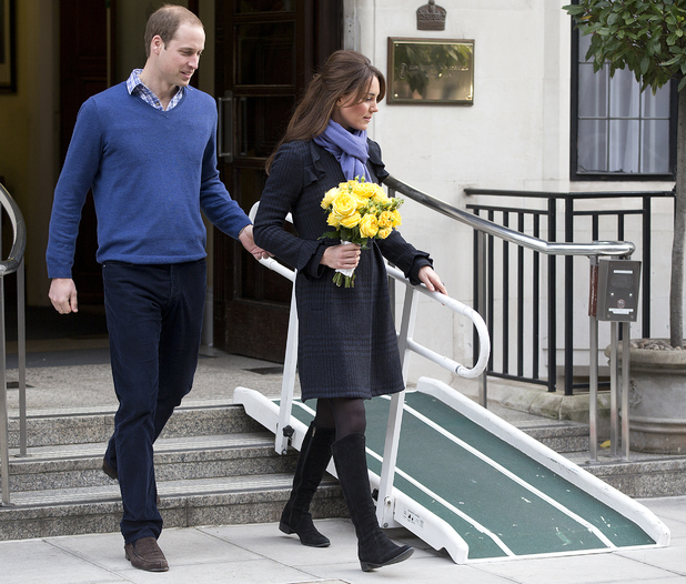 Britain's Prince William stand next to his wife Kate, Duchess of Cambridge as she leaves the King Edward VII hospital in central London, Thursday, Dec. 6, 2012. Prince William and his wife Kate are expecting their first child, and the Duchess of Cambridge was admitted to hospital suffering from a severe form of morning sickness in the early stages of her pregnancy.