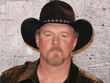 Trace Adkins explains that he likes watching Blake Shelton on the NBC series.