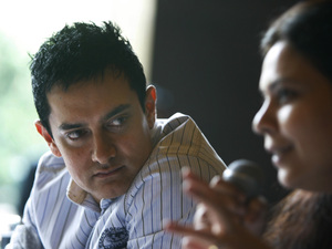 "Bollywood actor and producer Aamir Khan, left, looks on as director Anusha Rizvi speaks during a promotion of their upcoming film ""Peepli Live"" in New Delhi, India, Wednesday, July 7, 2010. ""Peepli Live"" is a satire on the urban-rural divide."