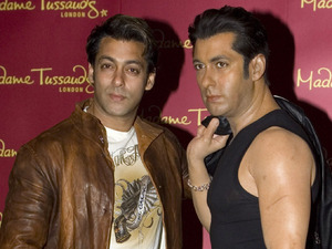 Salman Khan, left, poses with his new waxwork at Madame Tussauds, London. Tuesday, Jan. 15, 2008.