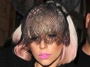 Lady GaGa leaving a London hotel wearing black lace bunny ears on her head London, England - 14.07.09