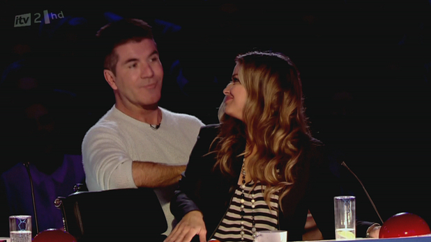 Carmen Electra sitting on Simon Cowell's lap on 'Britain's Got More Talent', shown on ITV2 England