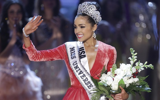 Miss USA, Olivia Culpo, waves to the crowd after being crowned as Miss Universe during the Miss Universe competition