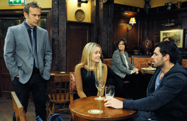 6447: Katie feels at ease chatting with Andy in the Woolpack when Declan enters, asking if she wants a lift back - Katie questions if she's not allowed a life now