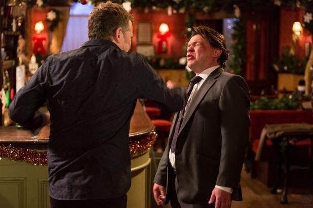 Alfie Moon punches Derek Branning