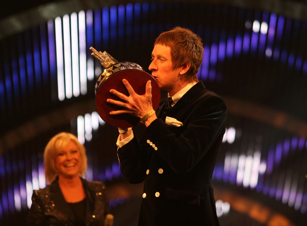 Bradley Wiggins kisses the BBC Sports Personality of the Year trophy