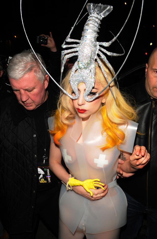 Lady Gagaarriving at Mr Chow restaurant in London, wearing a see-through plastic dress and a silver lobster headpiece following the final London date on her Monster Ball tour