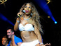 Sinitta strips on stage - pictures