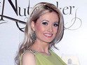 Holly Madison is pregnant with her first child and is still getting used to it.