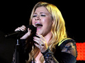 Kelly Clarkson says she is proud that her hit single has inspired others.