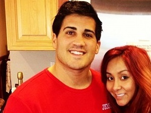 Snooki poses with fiance Jionni LaValle on Christmas Day