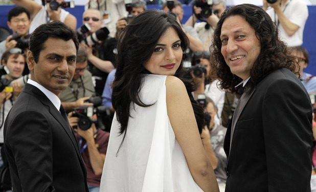 Nawazuddin Siddiqui, Niharika Singh and Anil George pose during a photo call for Miss Lovely at the 65th international film festival, in Cannes.