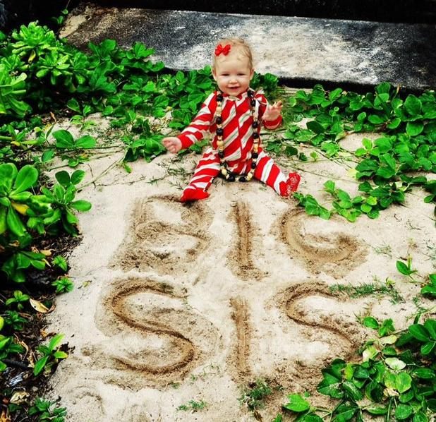Jessica Simpson Twitter picture of daughter Maxwell with 'Big Sis' sand drawing