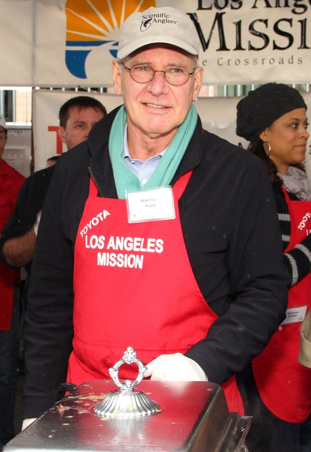 Harrison Ford helps with Los Angeles Mission Christmas Eve For The Homeless.