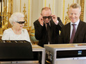 Queen Elizabeth II wears crystal 3D glasses to review Christmas Day TV broadcast.