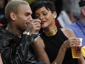 Chris Brown and Rihanna watch a basketball game together on Christmas Day.
