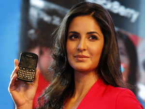 Katrina Kaif displays BlackBerry's new Blackberry Curve 9220, at a launch in New Delhi, 2012.