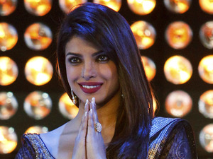 "Bollywood actress Priyanka Chopra takes the stage to award Lebanese director Ziad Doueiri The Golden Star award, the festival's grand prize, for his film ""The Attack"" during the 12th Marrakech International Film Festival in Marrakech, Morocco, Saturday, Dec. 8, 2012."