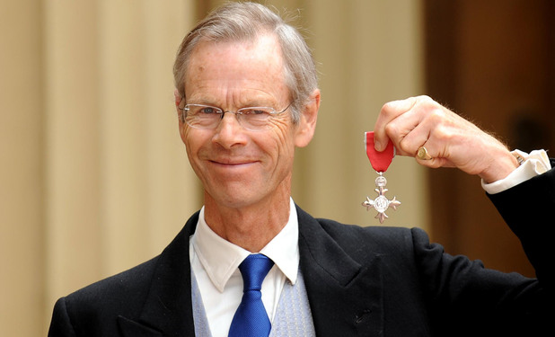 Cricket commentator and writer Christopher Martin Jenkins poses outside Buckingham Palace with his MBE