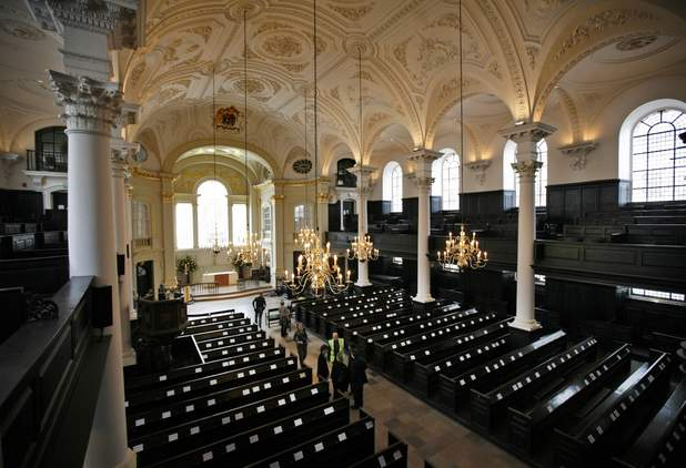 A worker is seen in the aisle of the St Martin-in-the-Fields church in central London's Trafalgar Square, during major refurbishment work,