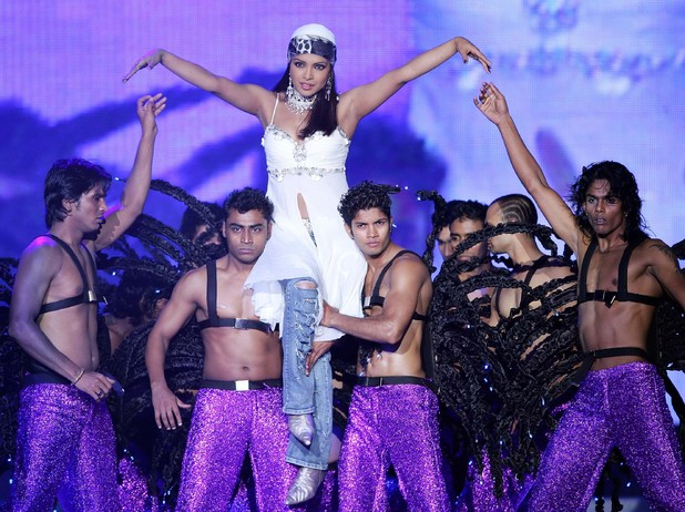 Indian pop star Priyanka Chopra, center, performs on stage during the Global Indian Film Awards (GIFA) held in Kuala Lumpur, Malaysia, early Sunday, Dec. 10, 2006.