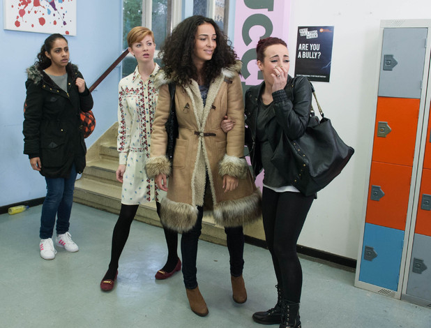 Sinead, Ruby and Phoebe watch as Esther walks away.