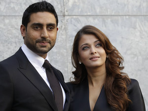 Indian actress Aishwarya Rai and her husband Abhishek Bachchan pose prior to attending the presentation of the Armani Spring-Summer 2011 fashion collection, during the fashion week in Milan, Italy, Monday, Sept. 27, 2010.