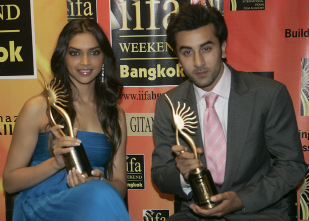 Bollywood actress Deepika Padukone, left, and actor Ranbir Kapoor pose with their awards for best female and male debut of the year during the 9th International Indian Film Academy awards 2008 in Bangkok, Thailand Sunday, June 8, 2008.