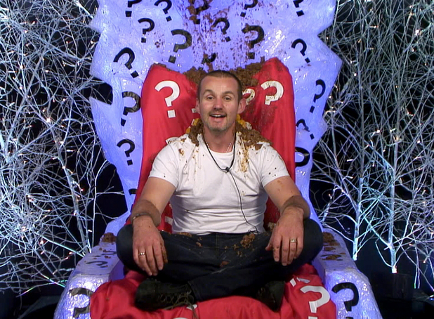 Ryan covered in dog food in the diary room for Day 8's task