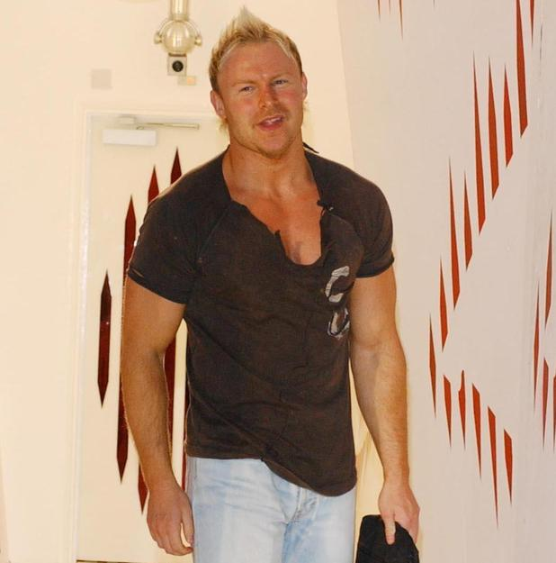 Jason Cowan poses for photographers, after leaving the house as second place runner-up during Big Brother 5's grand finale show in 2004