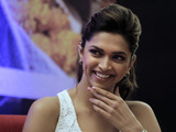 "Bollywood actor Deepika Padukone gestures during a press conference to promote her new film ""Aarakshan"" or ""Reservation,"" in New Delhi, India, Friday, Aug. 5, 2011."