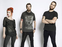 Hayley Williams reveals their guitarist listened to the Brit band in the studio.