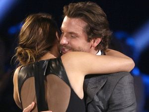 Bradley Cooper, right and Jennifer Lawrence are seen at the 18th Annual Critics' Choice Movie Awards at the Barker Hangar on Thursday, Jan. 10, 2013, in Santa Monica, Calif.