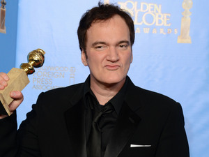 "Quentin Tarantino poses with the award for best screenplay for a motion picture for ""Django Unchained"" in the press room at the 70th Annual Golden Globe Awards"