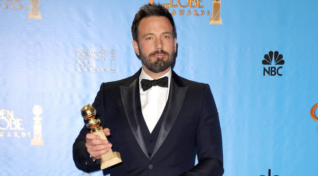 "Ben Affleck poses with the award for for best motion picture (drama) for ""Argo"" backstage at the 70th Annual Golden Globe Awards"