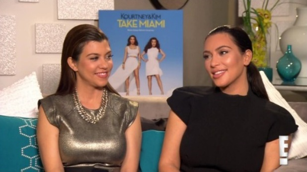 Kourtney and Kim Kardashian on E! news