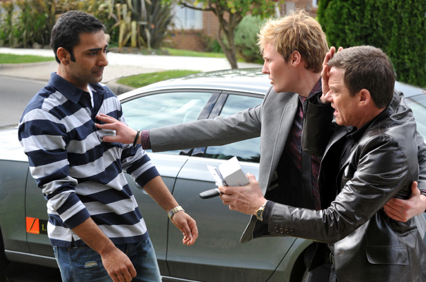 Andrew tries to separate Paul and Ajay.