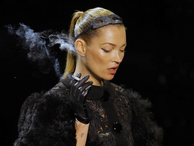 Kate Moss, British model Kate Moss wears a creation by American fashion designer Marc Jacobs for Louis Vuitton's Fall-Winter, ready-to-wear 2012 fashion collection, during Paris Fashion week, presented in Paris,