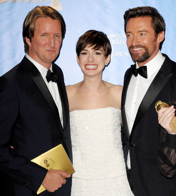 Les Miserables director Tom Hooper with Anne Hathaway and Hugh Jackman