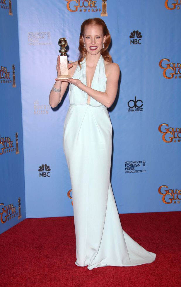 "Jessica Chastain poses with the award for best actress (drama) for ""Zero Dark Thirty"" backstage at the 70th Annual Golden Globe Awards"