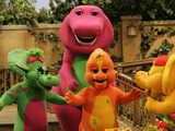 "Riff, front center, a new character on the ""Barney & Friends"" show, appears with the show's other dinosaur characters Baby Bop, left, Barney, rear, and B.J. during the taping of a new episode at the ""Barney & Friends"" studio in Carrollton, Texas, Tuesday, Aug. 29, 2006."