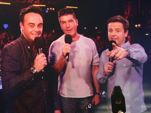 Ant and Dec accept the award for Best Entertainment Presenters with Simon Cowell during the 2013 National Television Awards at the O2 Arena, London.