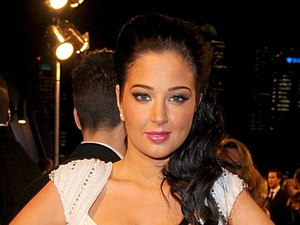 Tulisa arriving for the 2013 National Television Awards at the O2 Arena, London.