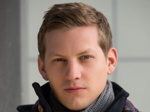 James Sutton as John Paul McQueen in Hollyoaks
