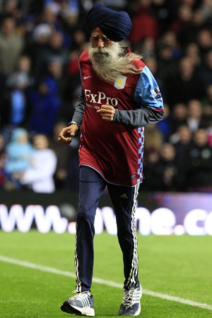 Fauja Singh, a 99 year old Aston Villa fan and marathon runner on the pitch at half-time - August 2010