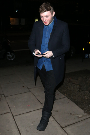 Caroline Flack and Hanna Tointon leave Groucho nightclub after having drinks with James Arthur. James left at the same time but used the side entrance of the trndy club. He then stopped off at a convenience store for cigarettes and headed home to his flat where he found he had locked himself out. The police stopped by to offer him some assistance