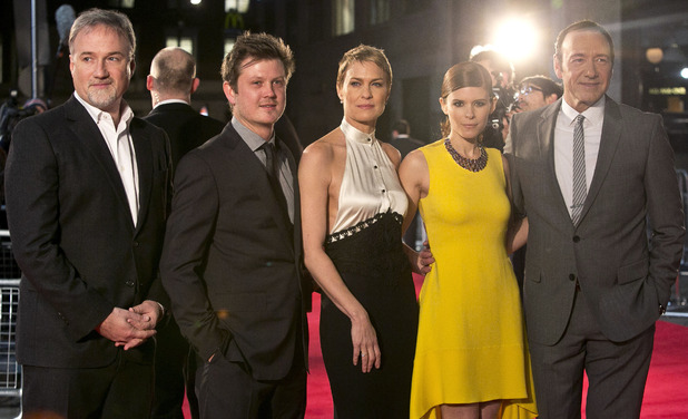 Director David Fincher, from left to right, and actors Beau Willimon, Robin Wright, Kate Mara and Kevin Spacey on the red carpet for the UK Premiere of 'House of Cards' at a Leicester Square cinema in London, Thursday, Jan. 17, 2013.