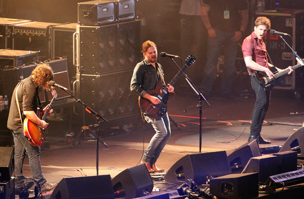 Kings of Leon&#39;s Nathan Followill (left), Caleb Followill (centre) and Jared Followill (right) in concert at Murrayfield Stadium in Edinburgh.